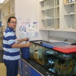 Dr. Reyes feeding frog and fishes
