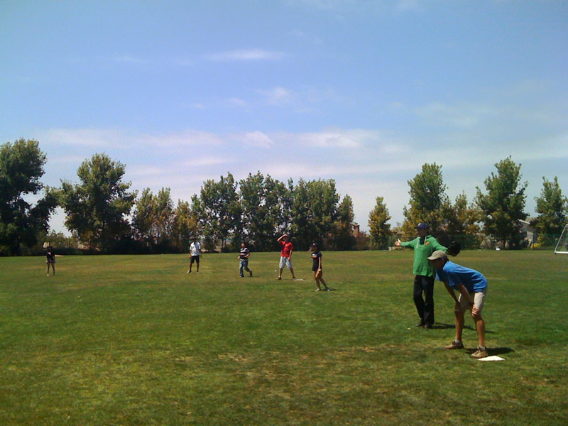 Playing softball w/ engineering faculty & students at annual Water & Environmental Engineering Picnic. June 2011