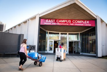 Illinois State students moving into the East Campus Complex