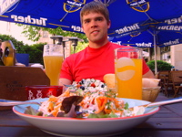 Adam Chambers is sitting down with a delicious looking plate of food in front of him.