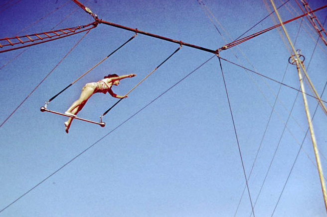 Aerialist Standing on Trapeze