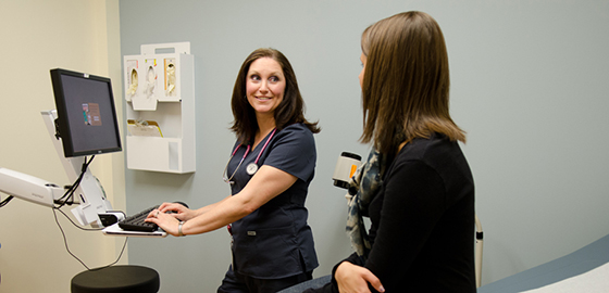 Student Health Services staffer helps a student