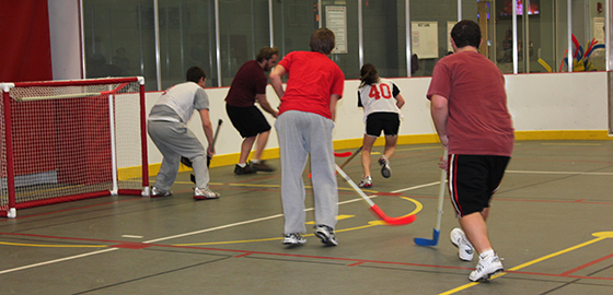 Students play floor hockey