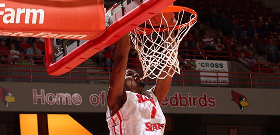 men's basketball player dunks