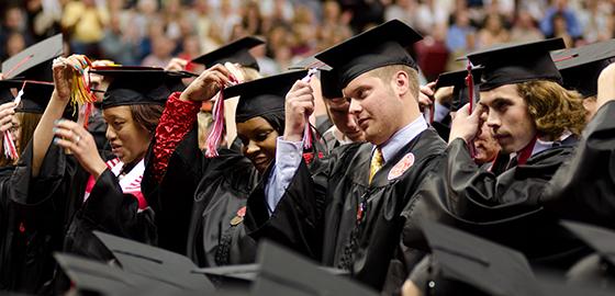 Students flip their tassels