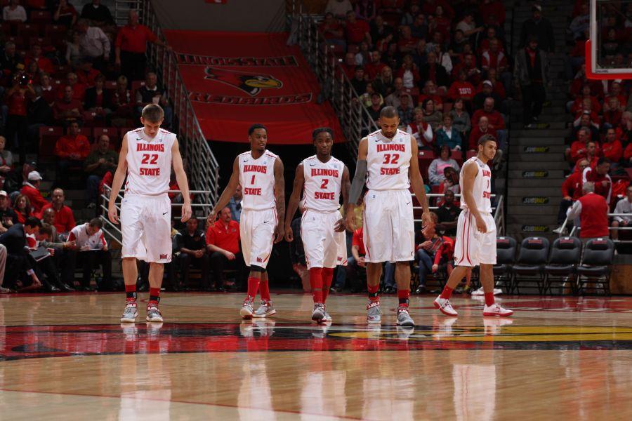 Redbird basketball players walk on court
