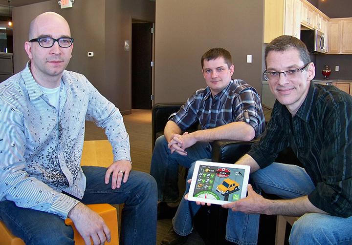 Three men from Spinlight Studio