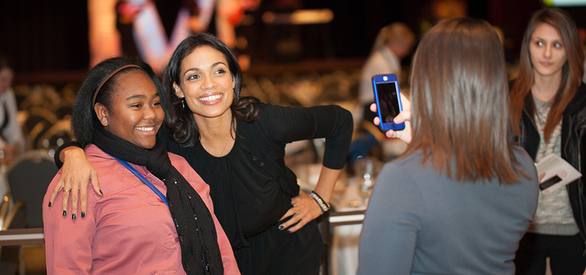 Rosario Dawson with a student