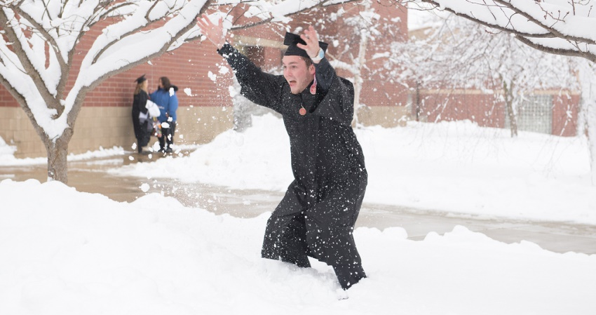 Graduate celebrates in the snow