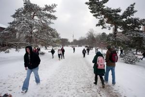 Students walk on snowy Quad