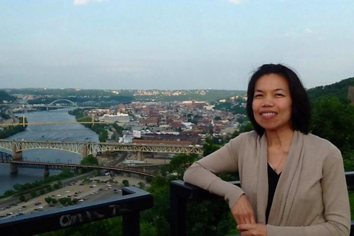 Yuwadee Viriyangkura overlooking downtown Pittsburgh at the 2013 American Association on Intellectual and Developmental Disabilities (AAIDD).