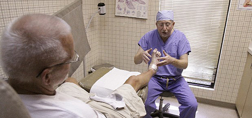 Misner talks to his patient