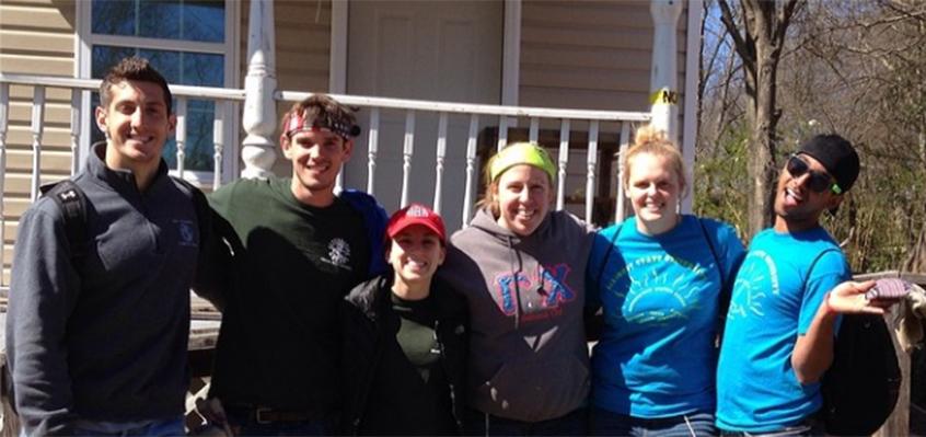 Students outside Habitat house