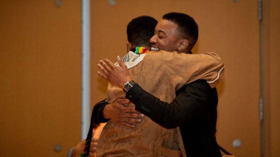 Master's graduate Anthony T. Williams Jr. rejoices