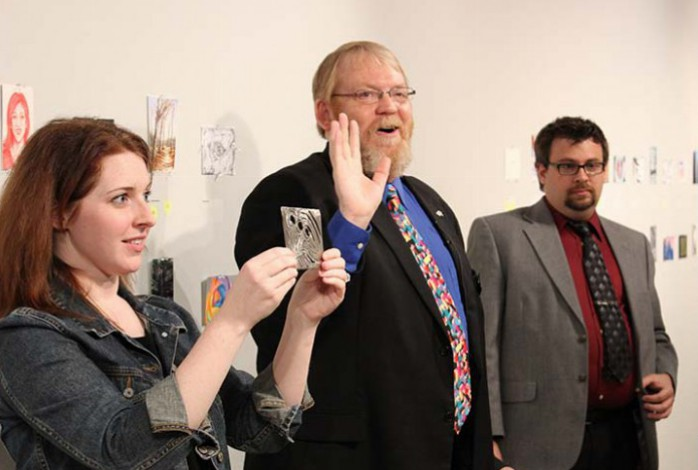 Photo of bidding at Friends of the Arts postcard art event