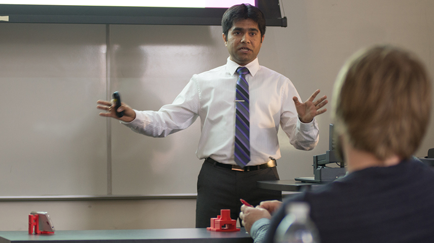 MBA student Aniruddha Godbole explains the process of creating and determining the market for his team's smartphone stand.