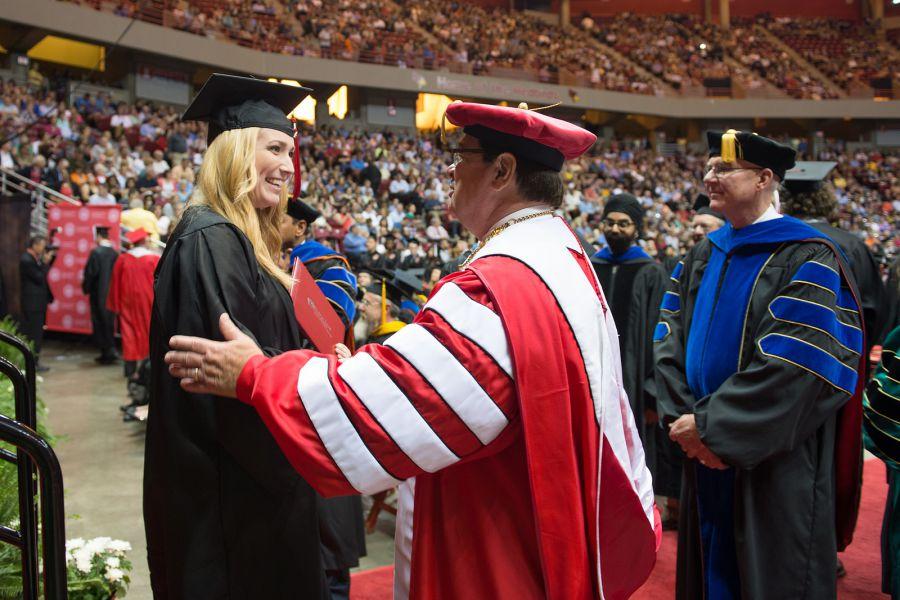 Larry Dietz congratulates a graduate