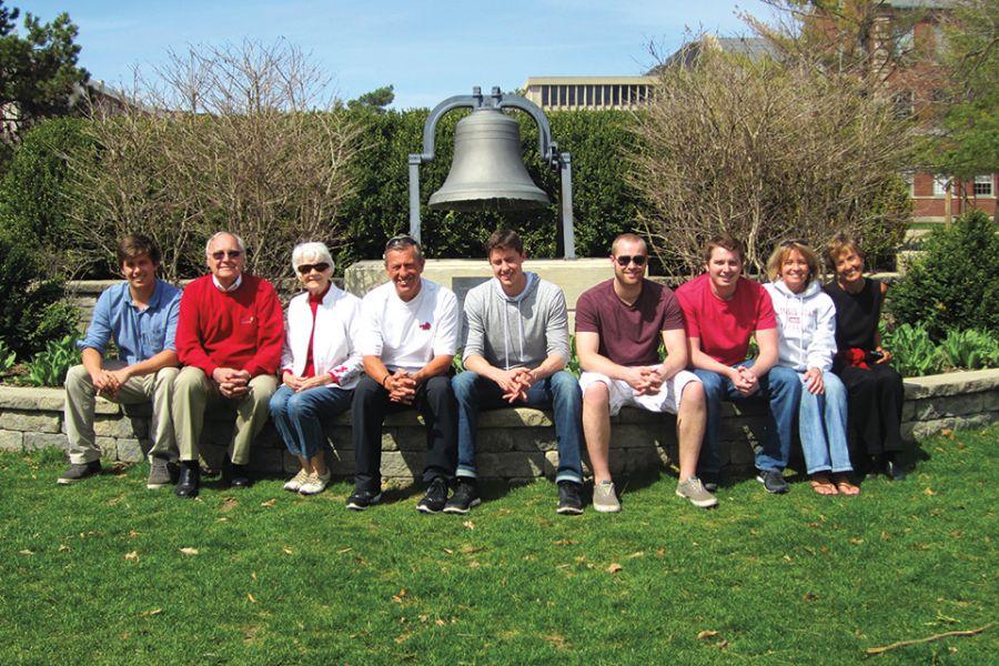 Redbird legacy family poses on Quad