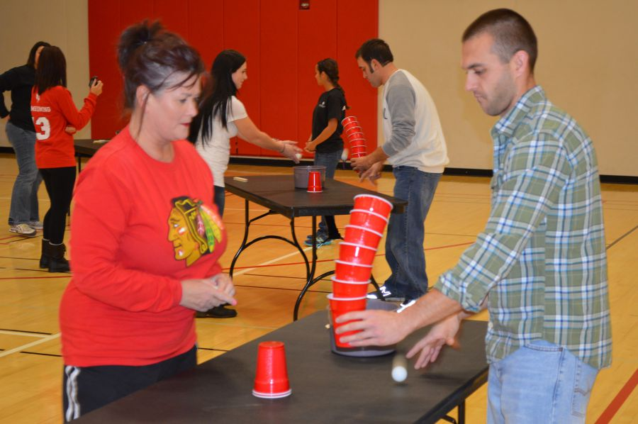 Woman and man playing Minute to Win It