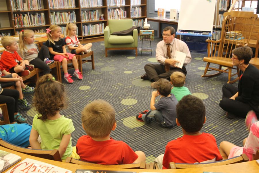 Illinois State University President Larry Dietz reads to Pre-K students in Thomas Metcalf' School's Zimmerman Library.