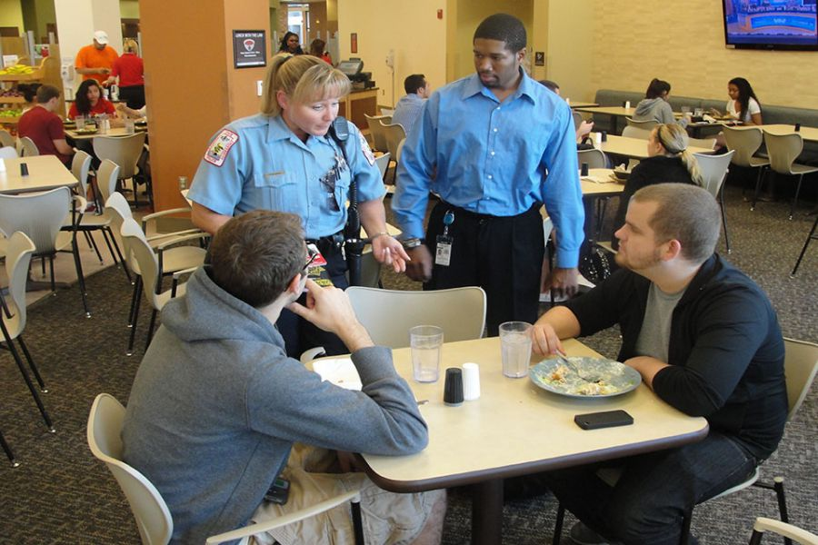 Police officers speak with students.
