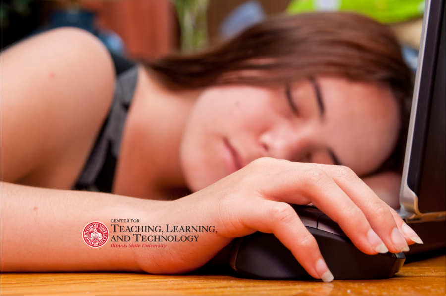 A student asleep with her hand on a mouse