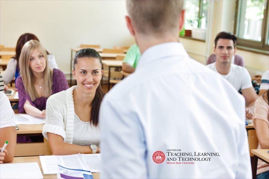 Teacher facing students in class