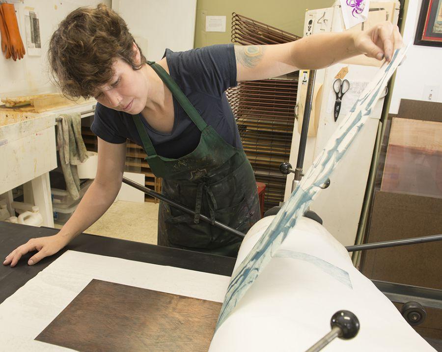 Lisa Lofgren doing printmaking