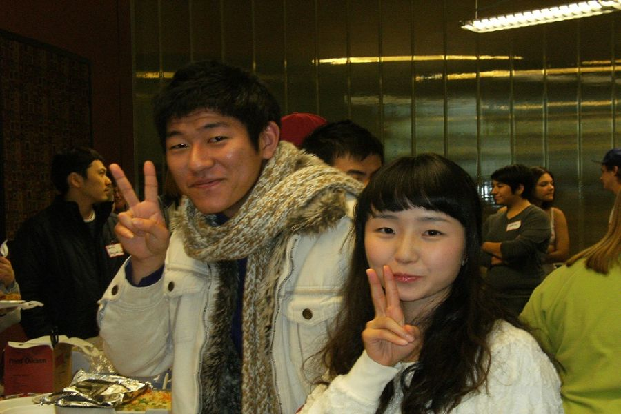 Men and woman showing peace sign