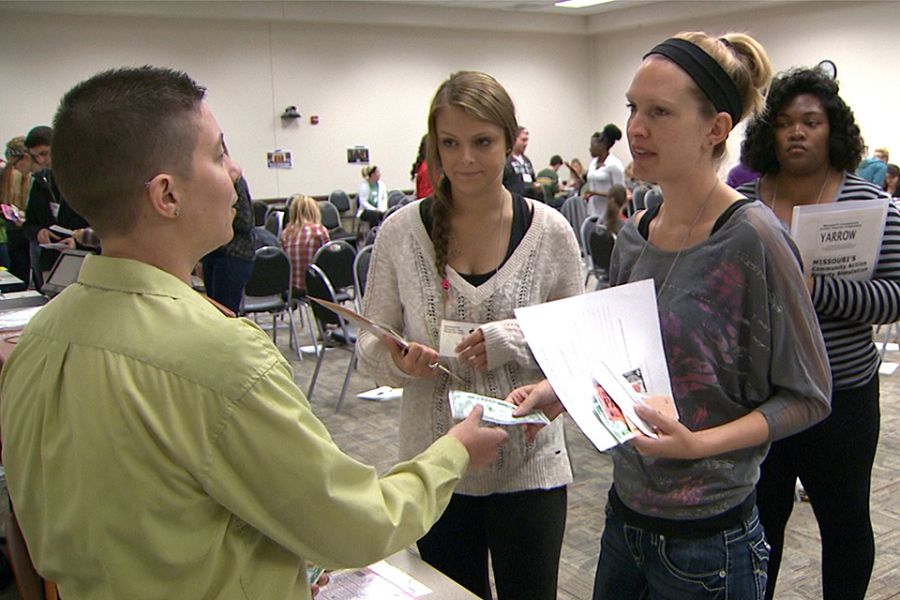 Alum works at poverty simulation
