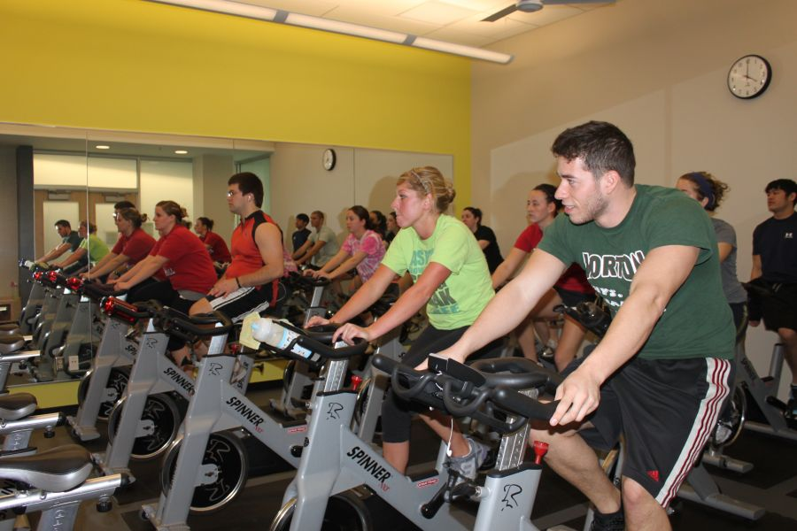 Students using stationary bikes