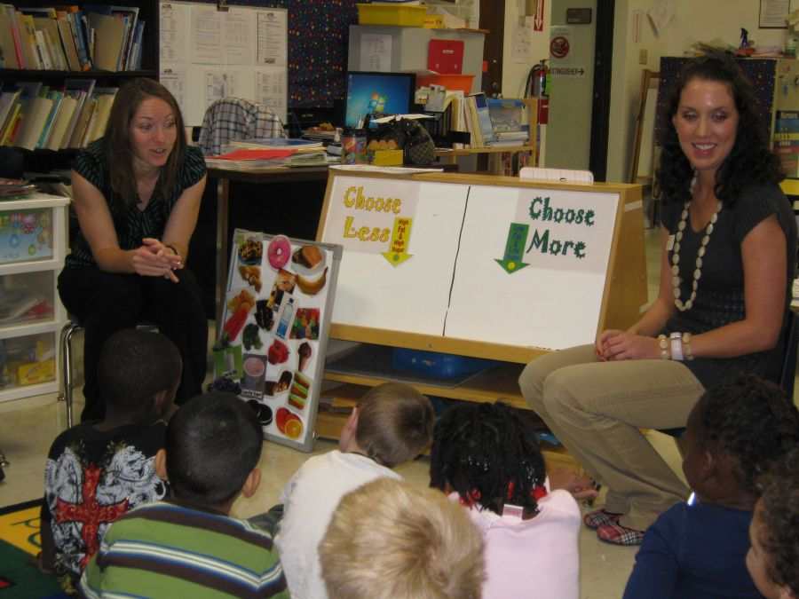 Julie McCoy talks to students
