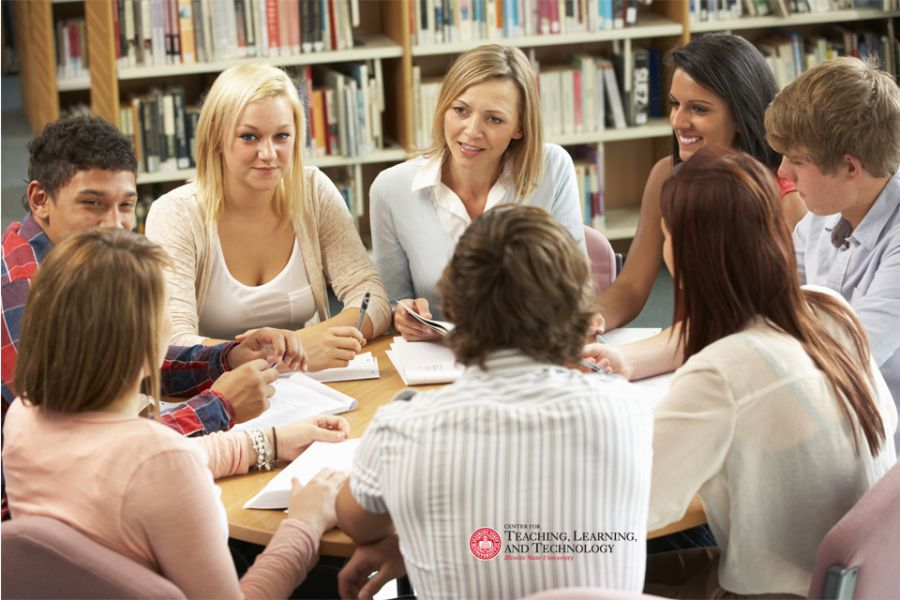 students in a circle in deep conversation