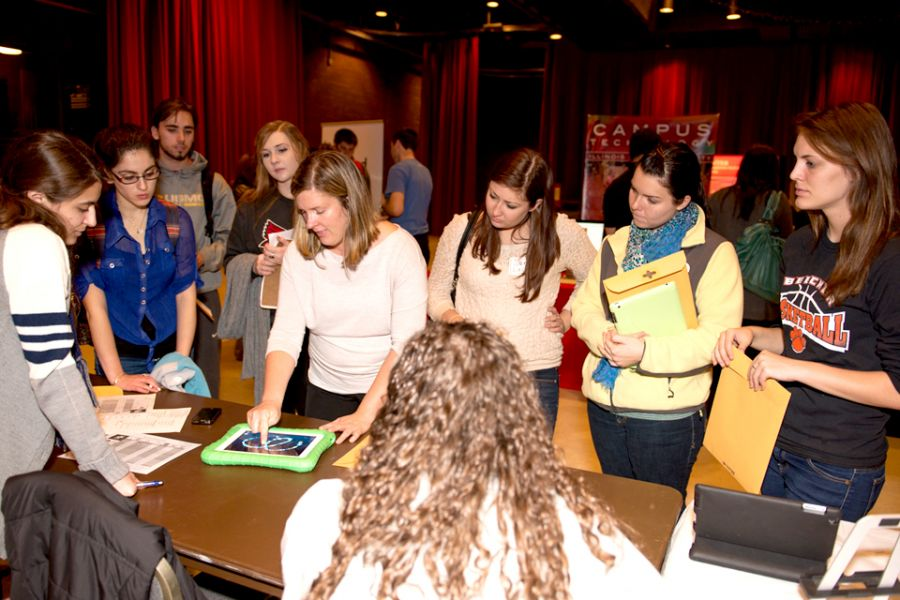 Students learn about classroom-friendly instructional apps in the Exhibitor Hall of T21CON.