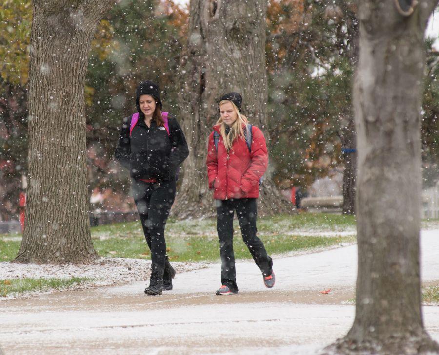students walk through the snow