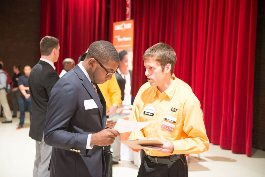 Two people talking at a career fair