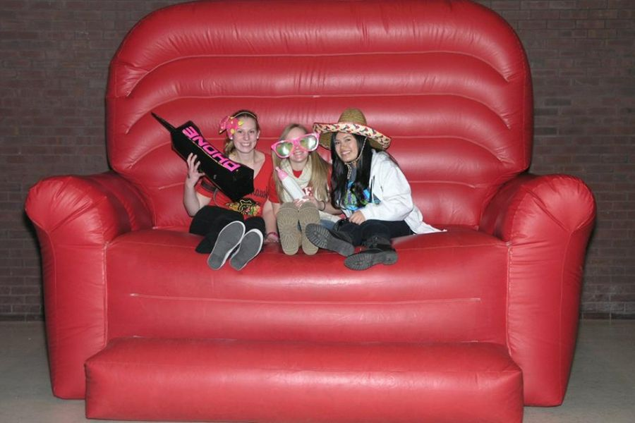 Students in a big red chair