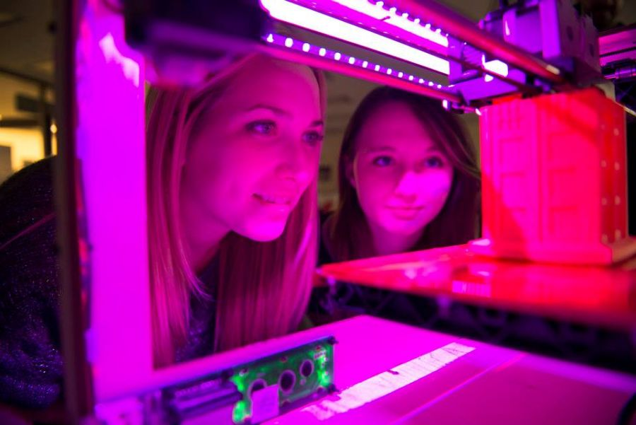 Redbird educators check out a 3-D printer at T21Con.