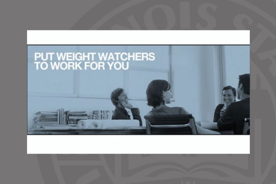 People at a desk with weight watchers in print