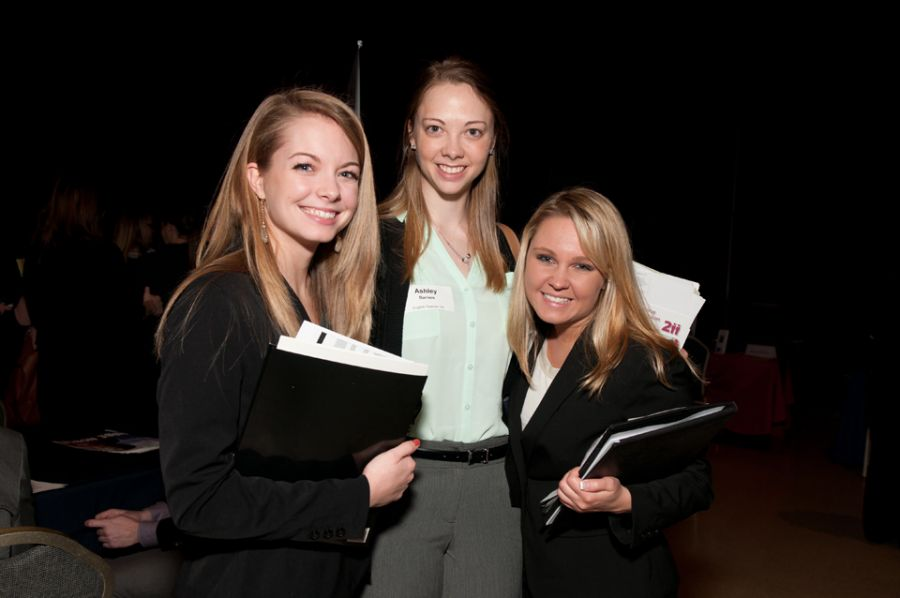 Three female students standing next to each other