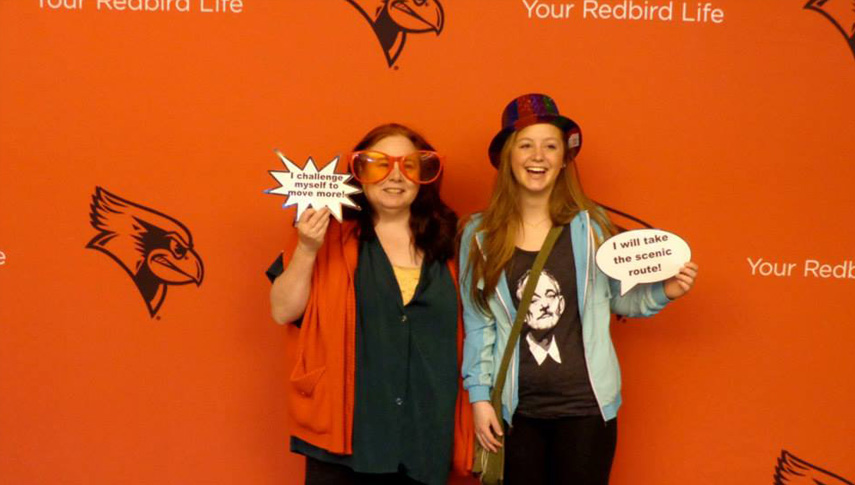 National Walking Day participants pose in the Your Redbird Life photo booth at the 2014 event.