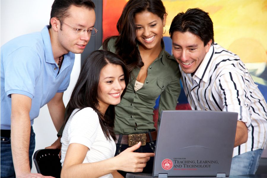 group of diverse students looking at computer