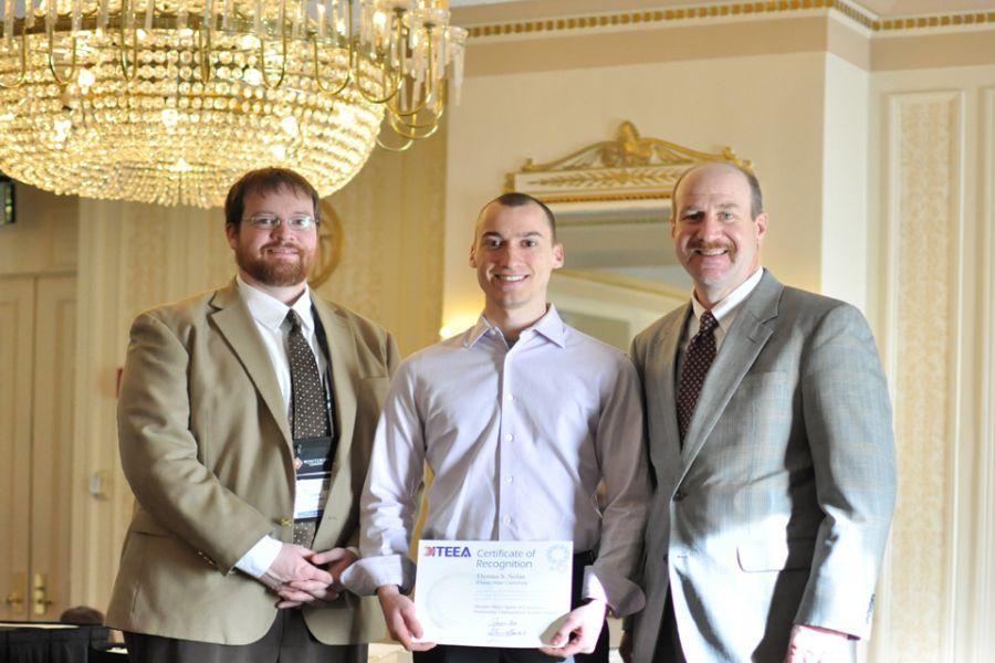 Technology Professor Josh Brown (left), Thomas Nolan, and Technology Professor Chris Merrill standing