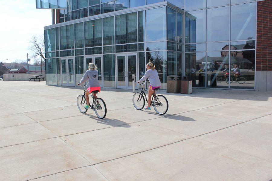 Students ride bikes near SFC