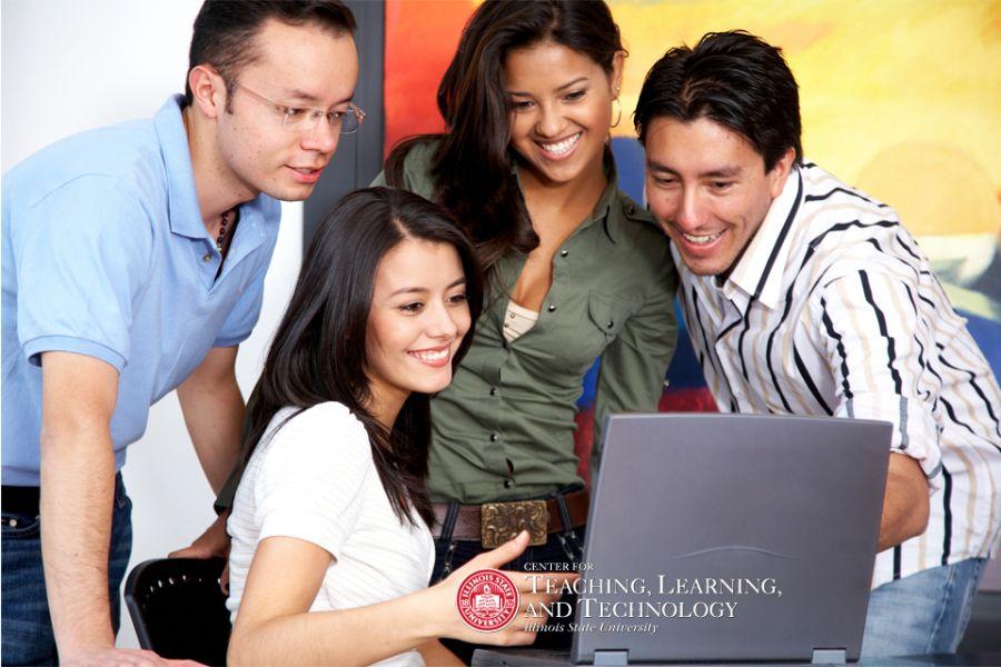 students gathered around computer