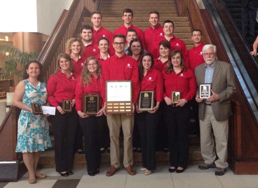 ISU NAMA students and advisor pose with awards