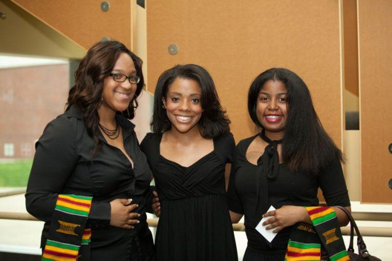 Graduating students pose at Umoja
