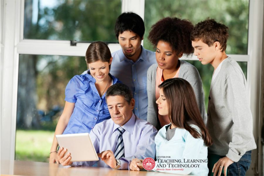 Students surrounding a faculty member
