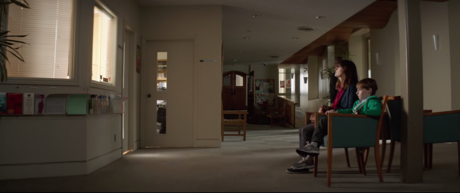 Woman sits in a room