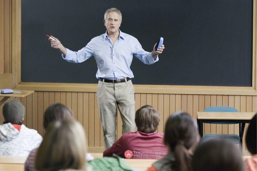 professor tweaching in front of a class